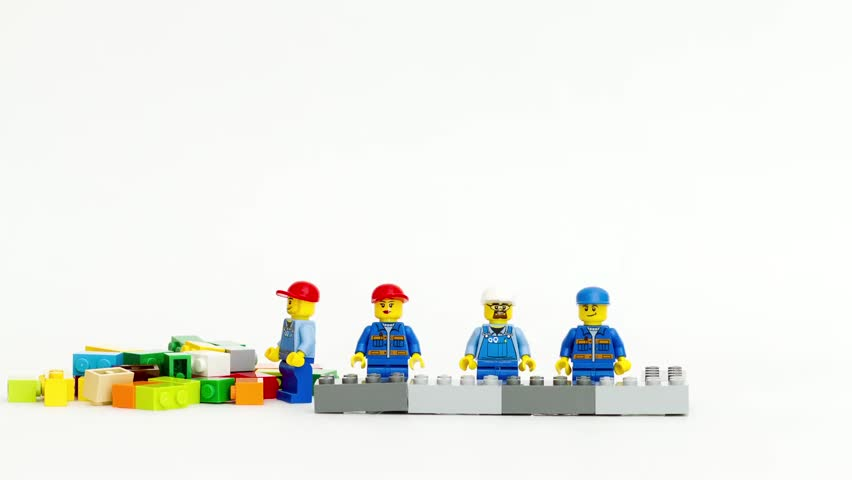 Orvieto, Italy - February 22th 2015: team of workman Lego mini figure build a wall in stop motion. Lego is a popular line of construction toys manufactured by the Lego Group