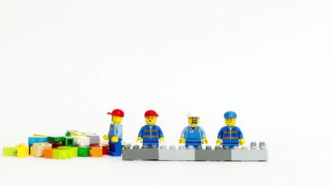 Orvieto, italy - february 22th 2015: team of workman lego mini figure build  a wall in stop motion  lego is a popular line of construction toys  manufactured by the lego group