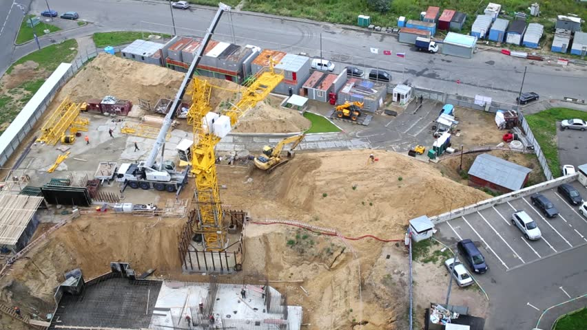 Construction site with lots of building machinery and building foundation | Shutterstock HD Video #8927923