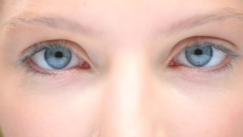 Blue Human Eyes. Beauty Macro Close-up Woman's eyes blinking. Beautiful young girl eyes closeup. Full HD 1080p