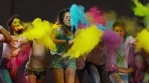 Colorful holi. Beautiful Youth. Holi festival of colorful kicks. Slow Motion. Shot on RED EPIC Cinema Camera 300 fps.
