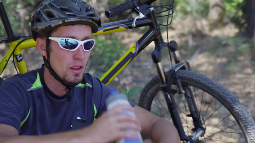 Closeup of mountain biker taking a water break
