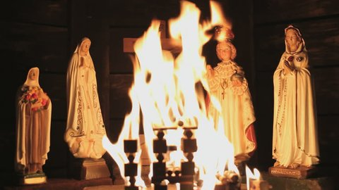 Ave Maria Statues with burning flames