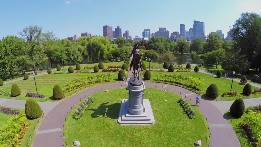 BOSTON - SEP 05, 2014: George Washington Equestrian Statue in Boston Public Garden with people at autumn sunny day. Aerial view. Public Garden was built in 1837.