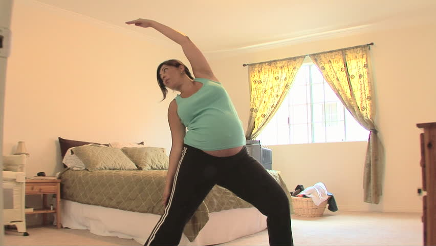 Pregnant woman doing yoga | Shutterstock HD Video #910633