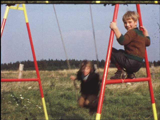 Children on swing (vintage 8 mm amateur film)