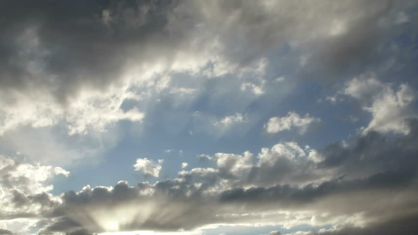 Timelapse of blue skies and bright sunshine reflection on the clouds. | Shutterstock HD Video #9148883