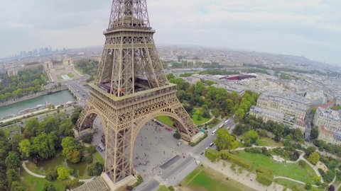 Cityscape with crowd of tourists walk near Eiffel Tower at autumn day. Aerial view