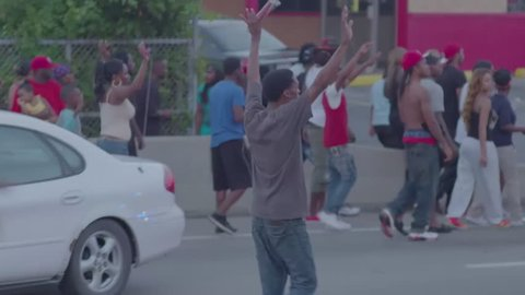 FERGUSON, MISSOURI - CIRCA 2014 - Protesters march and chant in the streets of Ferguson Missouri.