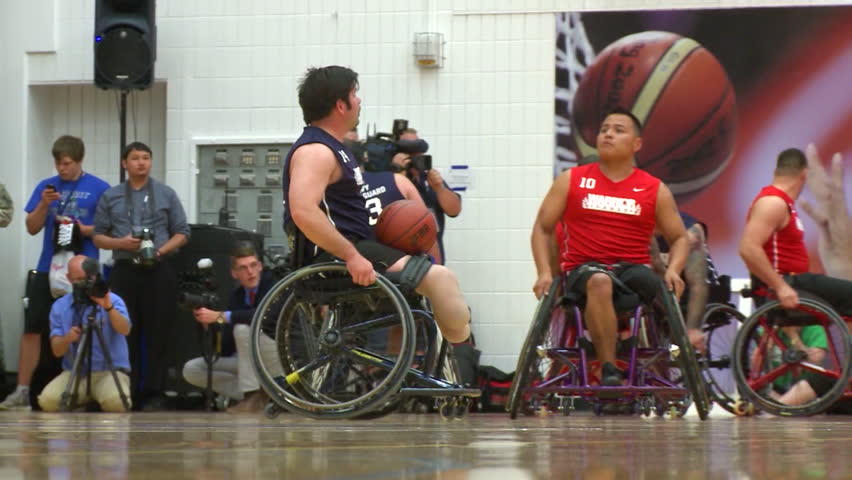 CIRCA 2010s - Wounded and disabled army veterans compete in wheelchair basketball.