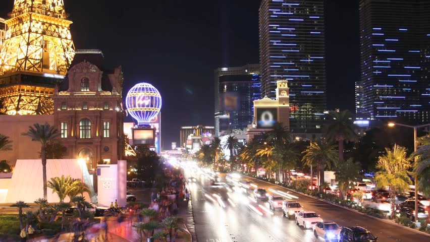 Time lapse Las Vegas Strip at night. All trademarks are blurred. License plates and faces cannot be identified.