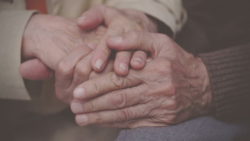 Extreme close up of elderly hands holding
