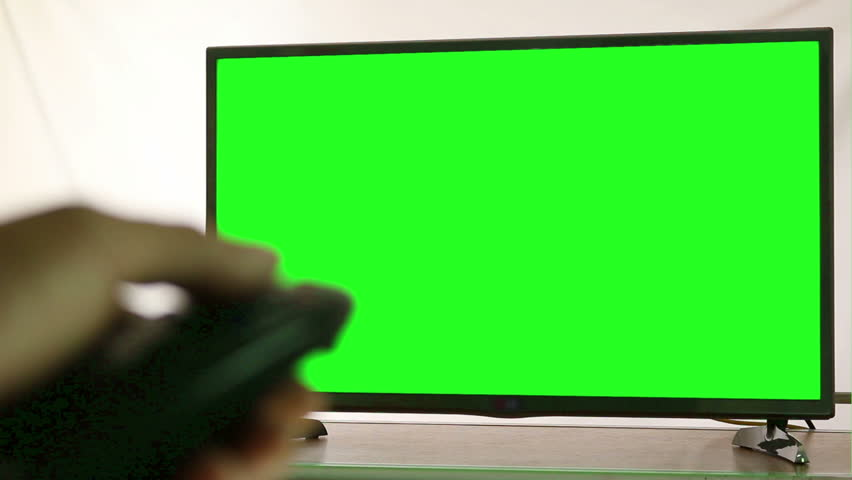 Smart tv and man pressing remote control, Green screen