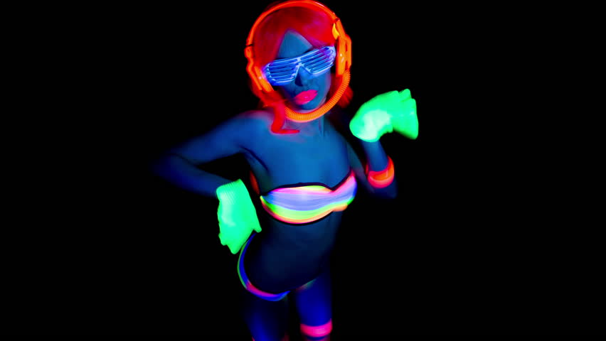 Sexy female disco dancer poses in UV costume  | Shutterstock HD Video #9236663