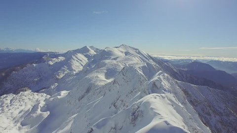 AERIAL: Huge snowy mountains in winter