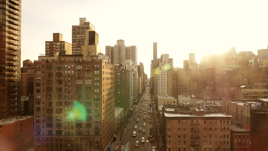 new york city landmark aerial view at sunset magic hour light. long street road. high rise real estate background