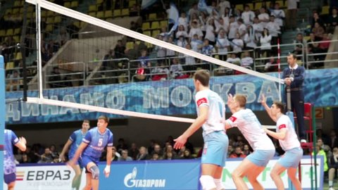 """MOSCOW, RUSSIA - FEBRUARY 25, 2015: Volleyball Championship match between teams """"Dynamo"""" (Moscow) - """"Gazprom-Yugra"""" (Surgut district)."""