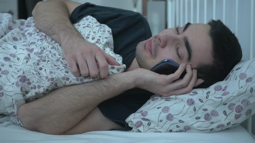 Αποτέλεσμα εικόνας για man talking on phone while sleeping