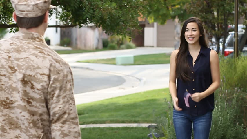 Military man returns to his wife after deployment overseas. Shot in Murietta, California in November of 2013.