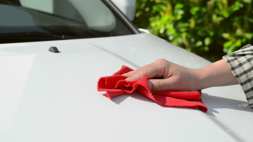 Car Care - woman polishing a white car with a red polishing cloth  | Shutterstock HD Video #9268643