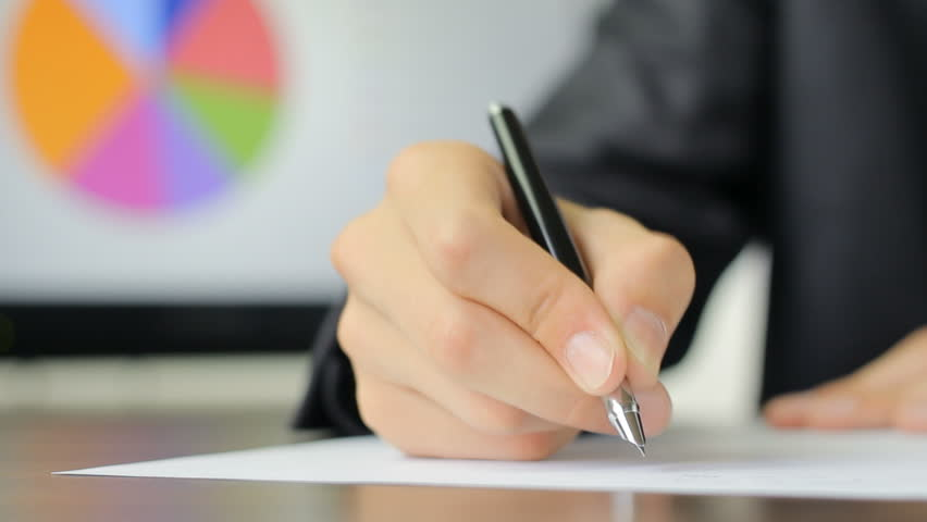 Close up of writing a formal letter at the office stock footage executive writing a letter about financial results hd stock video clip altavistaventures Images