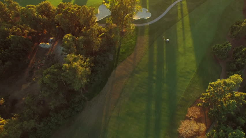 Los Angeles Aerial Golf Course v68 Turning vertical view aerial over golf course during sunset.