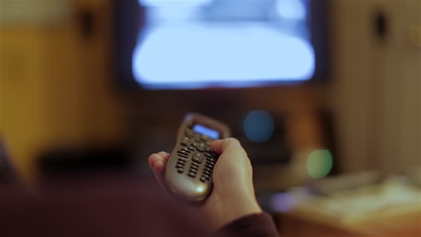 Changing TV channels with the remote.  | Shutterstock HD Video #9294983
