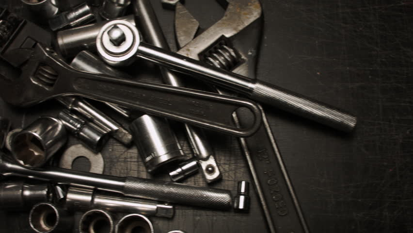 AUTOMOTIVE TOOLS CREATE A THING OF BEAUTY AS A GREASY MALE HAND PICKS UP A WRENCH.  VERSION 1 OF 3.  CLOSE UP. | Shutterstock HD Video #9307973