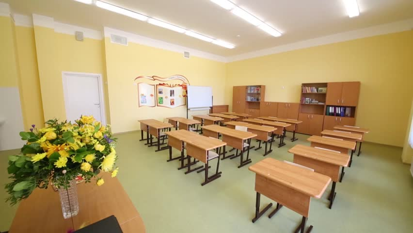 Modern Day Classroom : New modern school classroom with chairs on desks at sunny
