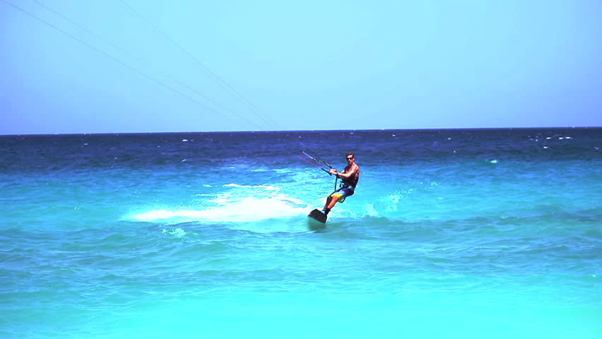 Professional Kite Boarder Doing Tricks on the Ocean in Anguilla - Caribbean Waters and Extreme Sports