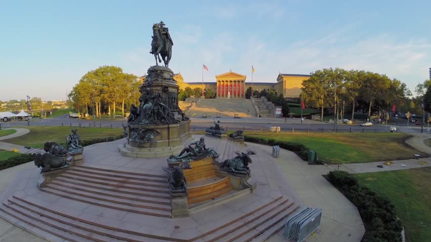 PHILADELPHIA - SEP 02, 2014: Cars ride by road near Statue of George Washington and Philadelphia Museum of Art at evening. Aerial view. George Washington was the first President of the United States.
