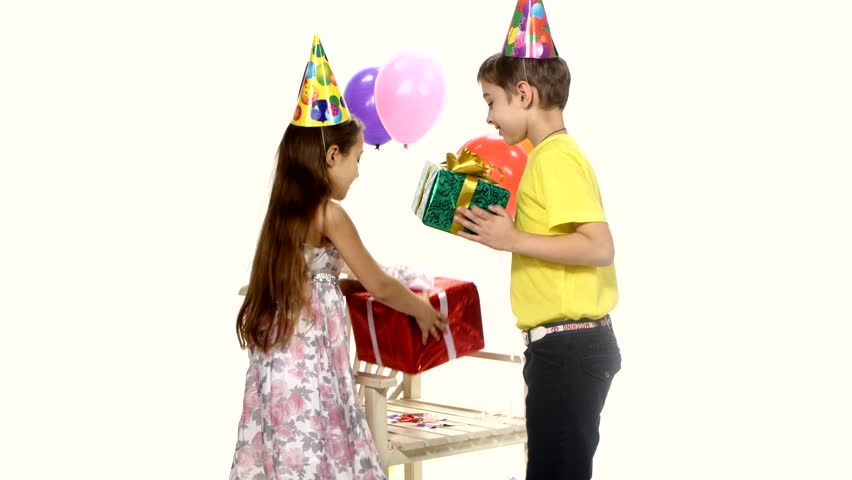 Children give gifts to the birthday girl at a time the girl children give gifts to the birthday girl at a time the girl accepts gifts and hugs stock footage video 9343343 shutterstock negle Gallery