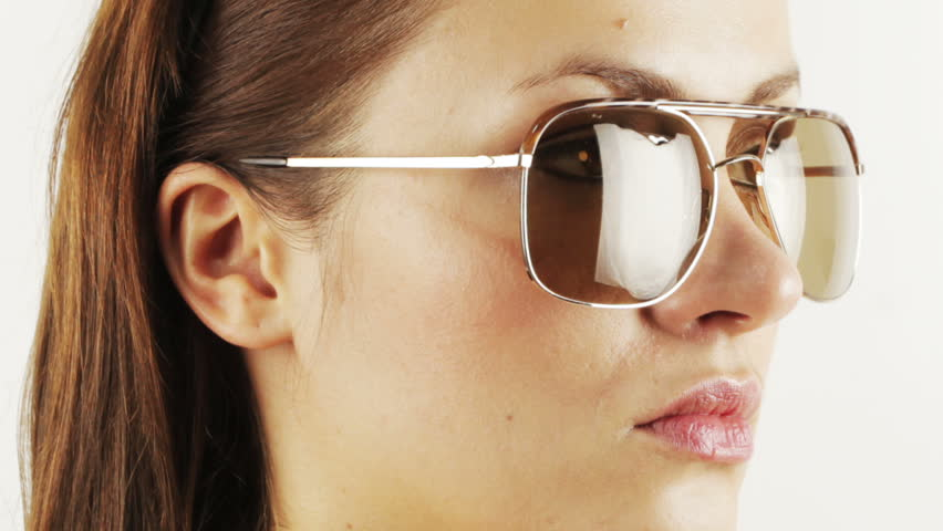 stop-motion of a pretty woman wearing different retro sunglasses