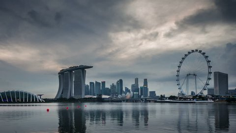 SINGAPORE, SINGAPORE - OCTOBER 2014: day till night coast view flyer and marina bay sands hotel 4k time lapse circa october 2014 singapore, singapore.