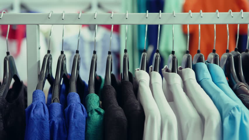 DOLLY MOTION: Variety of clothes hanging on rack in boutique | Shutterstock HD Video #9416393