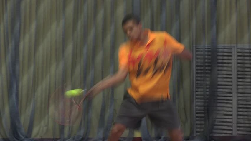 Tennis player in action. Moving on the base line. Making powerful shots | Shutterstock HD Video #9424433