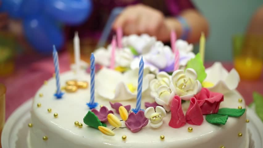 Child Hand Counts Candles On Birthday Cake Decorated With Cream Flowers
