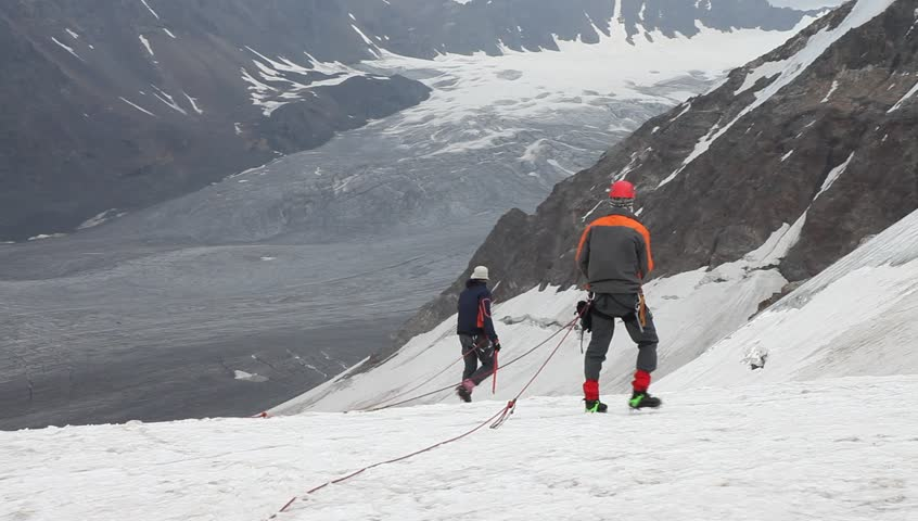 Two men climbing glacier in Kazakhstan mountains Dzungharski Alatau near China border | Shutterstock HD Video #9451493