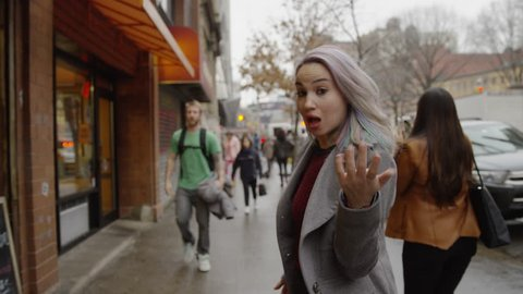 NEW YORK - MARCH 26, 2015: following attractive young tour guide woman leading us through the East Village, Manhattan, NY in 4k. The East Village is a residential neighborhood in New York City.
