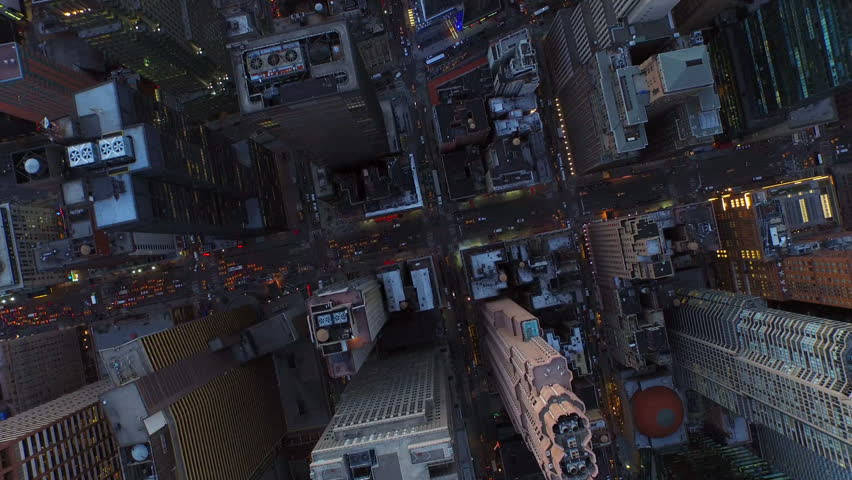 New York City Aerial v14 Vertical shot looking down over W 54th at 7th Ave and Broadway heading west just after sunset.