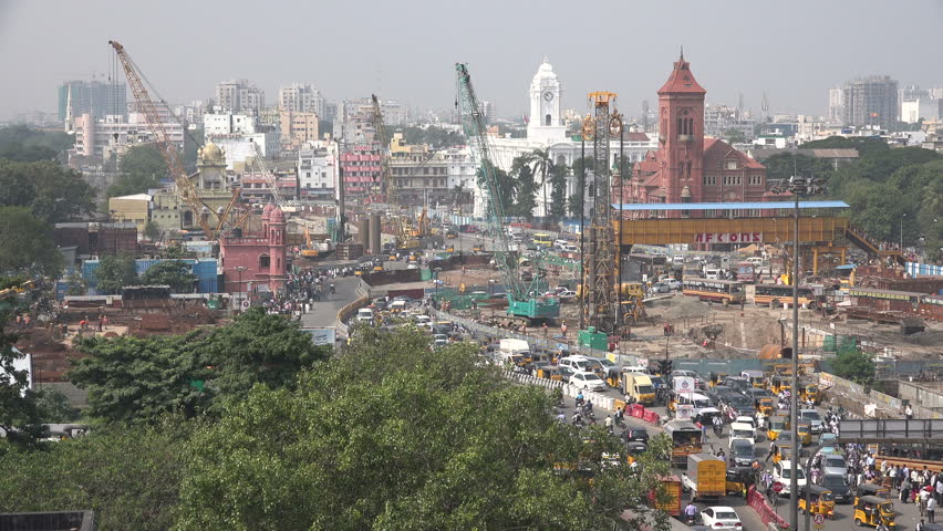 CHENNAI, INDIA - 26 NOVEMBER 2014: Overview of a busy intersection, the railway station, construction sites, and colonial buildings, in Chennai.