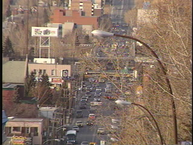 very long lens 14th street traffic train and traffic busy