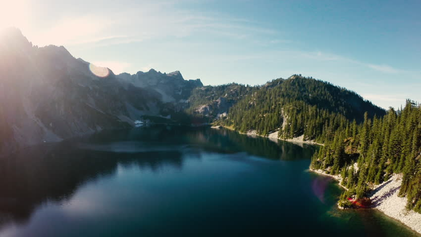 Aerial of flying sunny mountain lake view of Snow Lake near Alpental in the Washington State Cascade Mountains