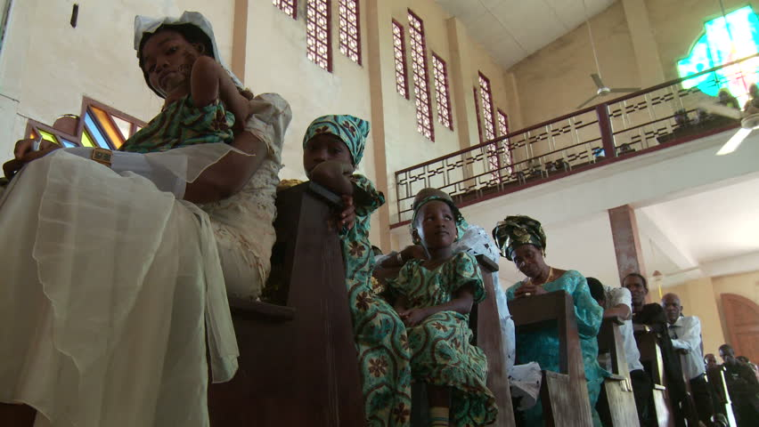 Africa, Nigeria, Imo State. December 8, 2009. Low angle shot of mainly women and children attending church service in Nigeria. | Shutterstock HD Video #9497591