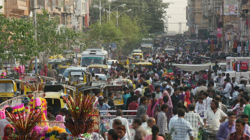 JODHPUR, INDIA - 23 OCTOBER 2014: Large crowds walk through the streets of Jodhpur, in anticipation of the annual Diwali festival in India.