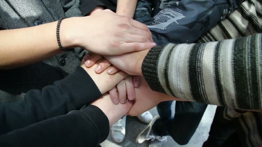 young male hands folded on one another showing friendship