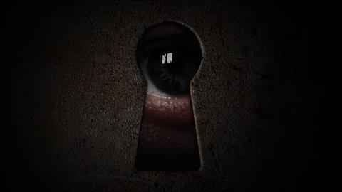 Eyes watching through a keyhole. Watch through the dark keyhole