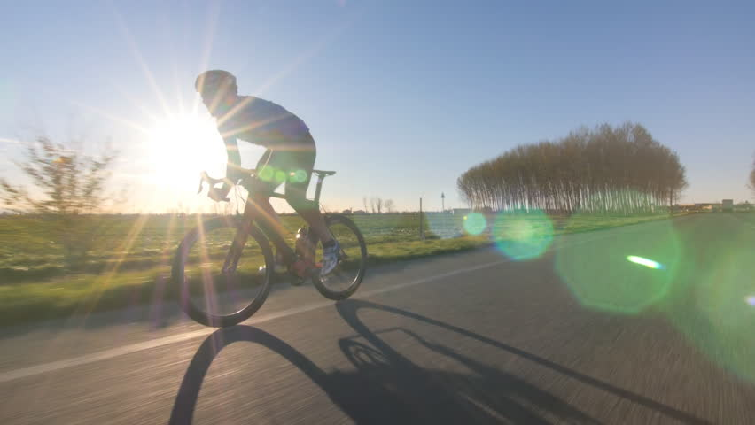 cyclist working out. training fitness outdoors on bike. tracking shot from camera car 4k #9521582