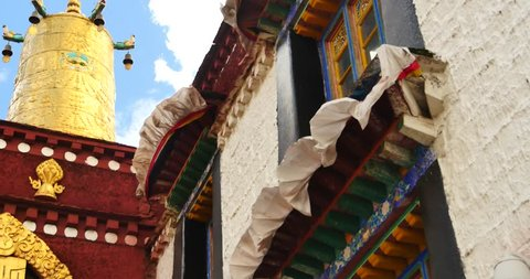 4k closeup of The Jokhang Temple In Lhasa,Tibet,white clouds in blue sky. gh2_09674_4k
