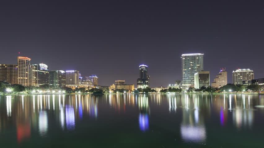 ORLANDO, FLORIDA, USA - OCT 30, 2014: 4K Time lapse zoom out of the twilight morning sun rising on the skyline of Orlando at lake Eola